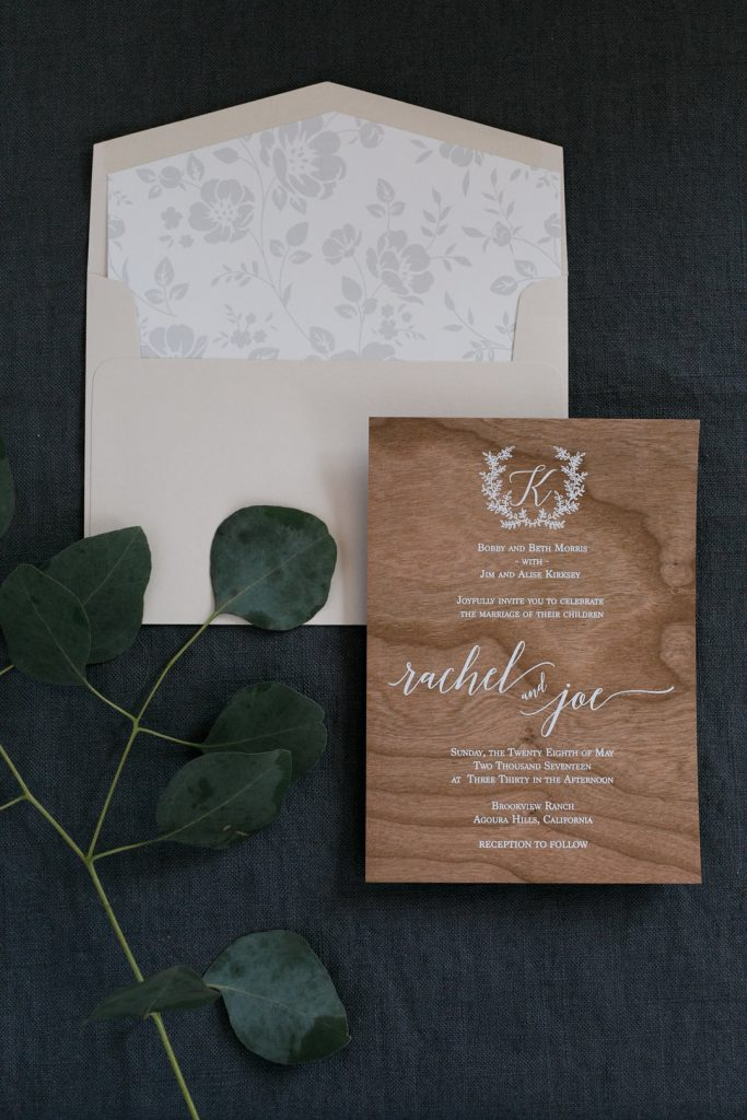 Rustic Wood Invitations with White Text for Malibu Wedding