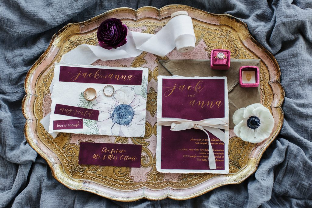 Watercolor and Velvet Invitaitons featuring handmade paper, gold foil, and silk ribbon